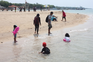 Playing sand at pantai sembilan